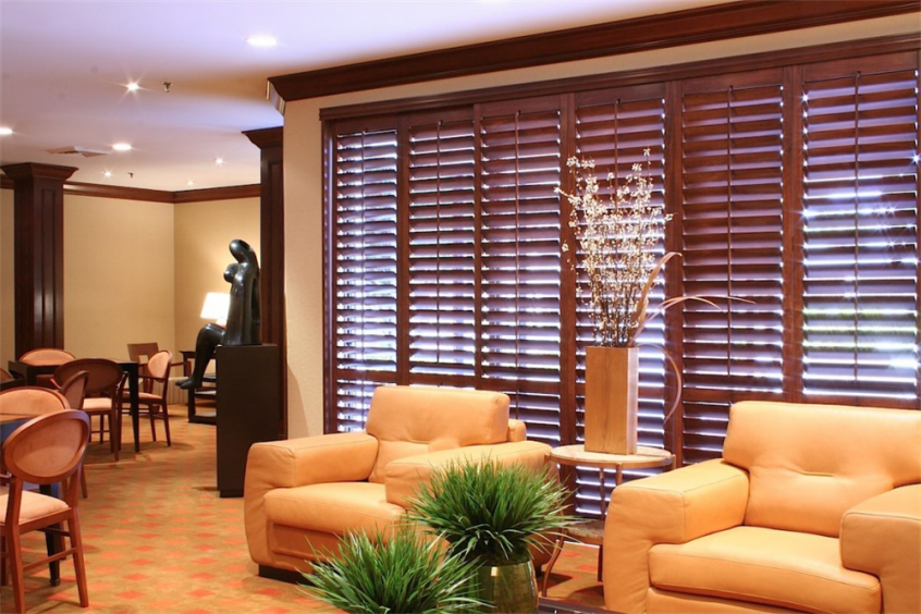 dark brown wooden shutters - Southern California Window Coverings
