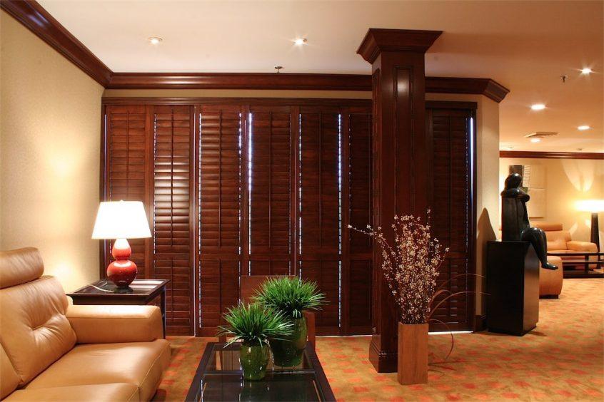 Wooden Shutters In Living Room - San Diego Shutters