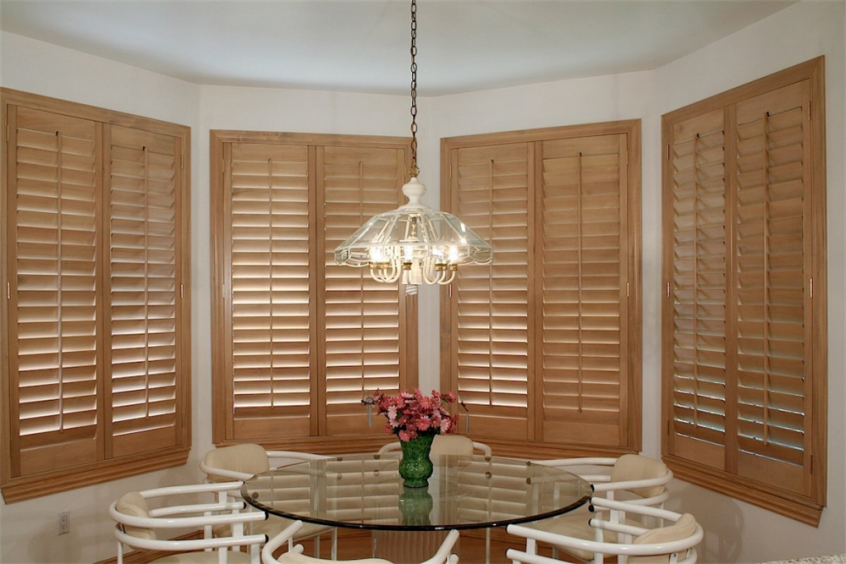 tan shutters in dining room - Southern California Window Coverings